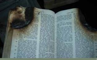 현지교회가 불타면서 오픈도어가 제공한 성경도 탄 흔적