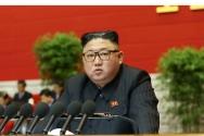 북한 김정은 국무위원장이 지난 6일 노동당 8차 대회 2일차 회의에서 사업총화 보고를 하고 있다.